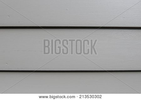Close Up of Three Gray Siding Boards Baxkground