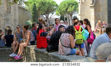 Carcassonne, Languedoc-roussillon, France - August 24 2017: Large Group Of Young People Gathered Out