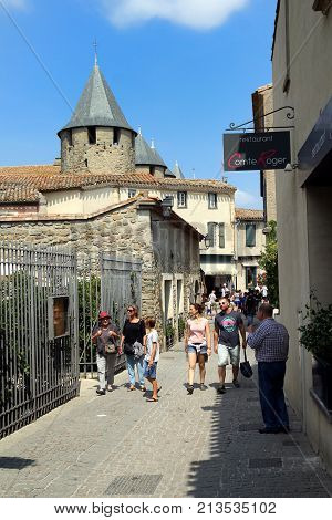 Carcassonne, Languedoc-roussillon, France - August 24 2017: Tourists Enjoying The Sunshine Along A C