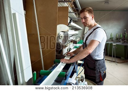 Worker In The Workshop Prepares Pvc Profiles