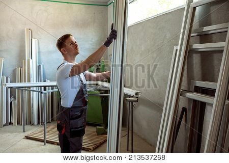 Worker In The Workshop For Making Pvc Windows And Doors