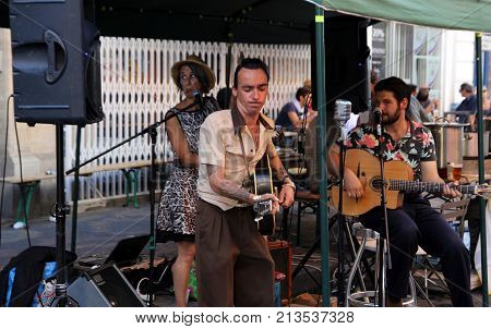 Sete, Herault, France  - Aug 21 2017: Trio Of Musucians With Guitars And Singing At An Open Air Even