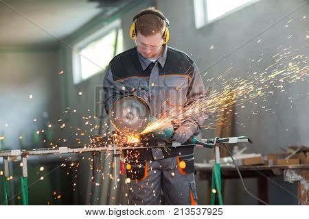 Worker Cutting Metal With Grinder.