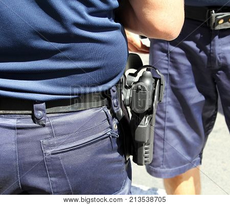 Sete, Herault, France  - Aug 21 2017: Close Up Of The Hand Gun Worn In A Holster By A French Police