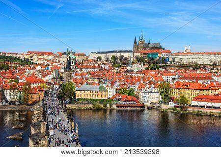 View of Mala Strana, Charles bridge and Prague castle from Old Town bridge tower over Vltava river. Prague, Czech Republic