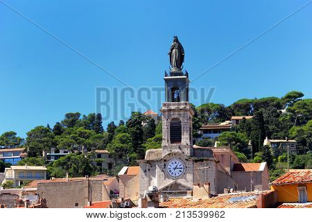 Sete, Herault, France  - Aug 21 2017: Statue On Top Of The Clock Tower Of The Church Of Saint-louis