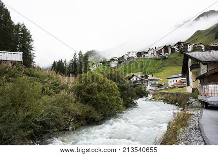 Stream And Glacier From Alps Highest And Most Extensive Mountain Range Flowing Passed At Villages Of