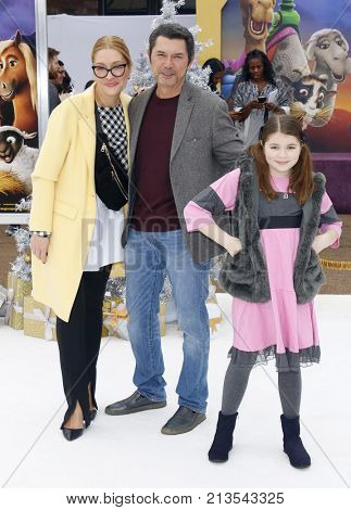 Lou Diamond Phillips, Yvonne Boismier Phillips and Indigo Sanara Phillips at the Los Angeles premiere of 'The Star' held at the Regency Village Theatre in Westwood, USA on November 12, 2017.
