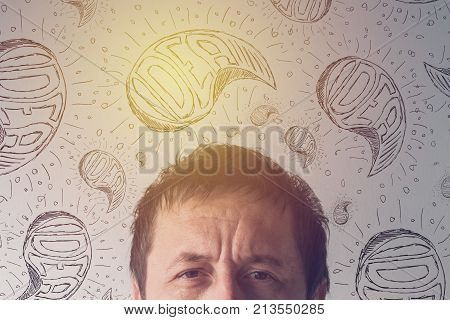 Creativity creative ideas and brainstorming concept with headshot portrait adult male person thinking and contemplating.
