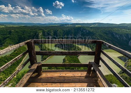 Viewpoint of meanders at rocky river Uvac gorge on sunny day, southwest Serbia