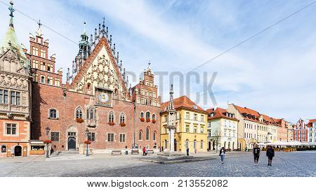 Tourists And Old Town Hall On Square In Wroclaw