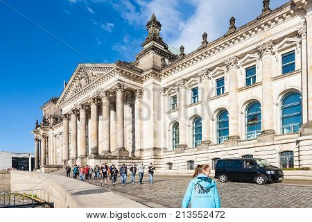 Visitors In Front Of Reichstag Palace In Berlin