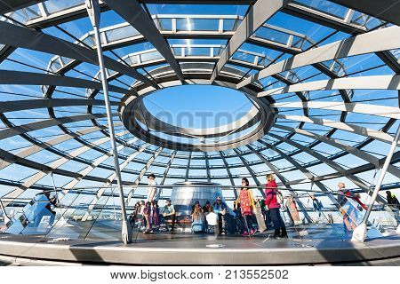 Tourists On Excursion In Reichstag Dome In Berlin