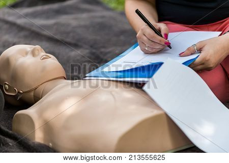 Cpr Training Outdoors. Reanimation Procedure On Cpr Doll, Toned Image