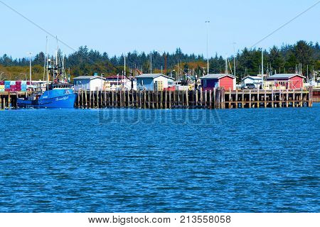 October 14, 2017 in Crescent City, CA:  Fishing vessels, yachts, and sail boats docked at the Crescent City Marina Harbor in Crescent City, CA where people can dock their boats and buy fresh fish from fishing vessels at this marina