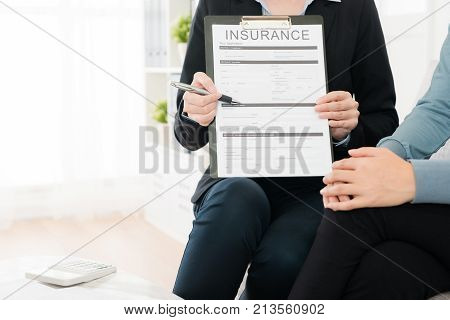 Closeup Of Insurance Agent Visiting Buyer's Home