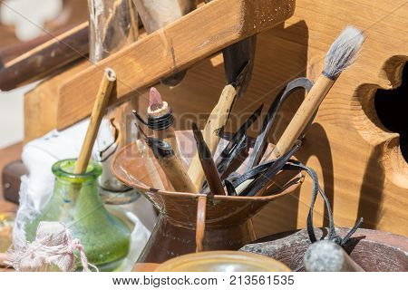 Traditional historical medieval writing calligraphy illumination tools, pen, nibs, knife, brush, pots ink