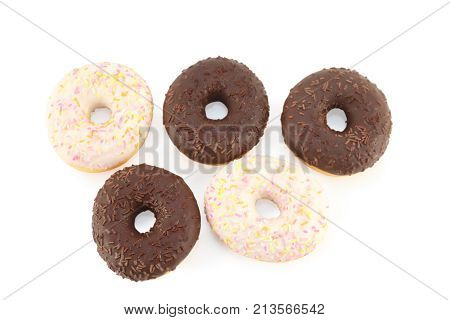 Five white and chocolate donuts isolated on white above view