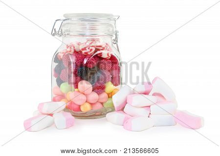 Glass jar with sweet candies and marshmallows isolated on white background