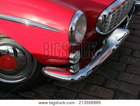 HELSINKI FINLAND - AUGUST 7 2017: Beautiful details of vintage red car on the front side at Helsinki Retro Cars Show on Kauppatori square August 4 2017A closeup of .