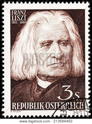 LUGA RUSSIA - AUGUST 20 2017: A stamp printed by AUSTRIA shows image portrait of famous Hungarian composer virtuoso pianist conductor and music teacher Franz Liszt circa 1961
