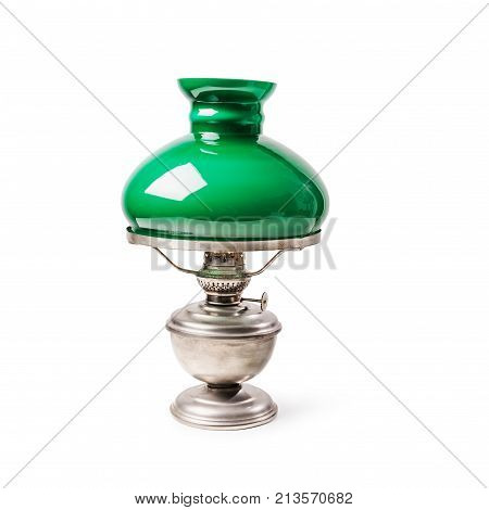 Vintage table lamp with green lampshade isolated on white background. Antique oil lamp. Single object with clipping path