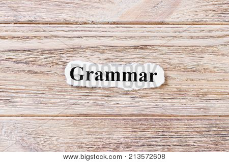Grammar of the word on paper. concept. Words of Grammar on a wooden background.
