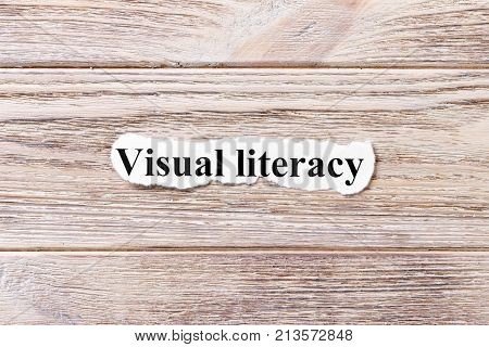 visual literacy of the word on paper. concept. Words of Avisual literacy on a wooden background.