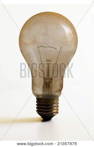 Dusty burned out light bulb