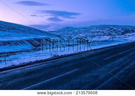 Typically winter  view at dawn from The Ring Road (Route 1) of Northeast of Iceland, near Egilsstadir.