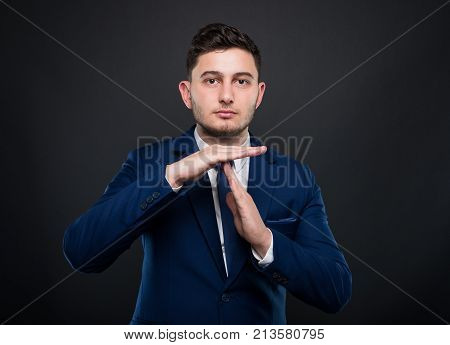Handsome Entrepreneur Showing Time Out Sign