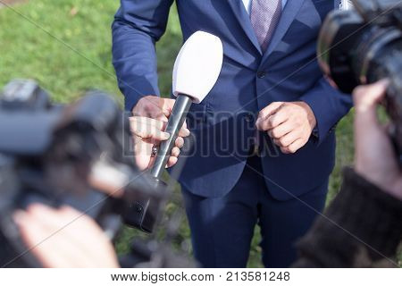 TV media or press interview with business person or politician