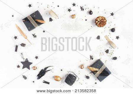 Christmas composition. Christmas gifts pine cones black and golden decorations on white background. Flat lay top view