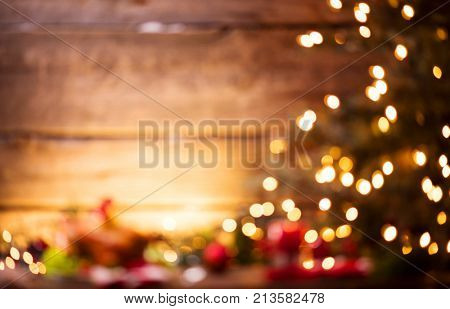 Christmas Holiday Blurred Background, Xmas table background with decorated Christmas tree and garlands. Beautiful Defocused Empty Christmas room. New Year Frame for your text