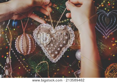 Christmas handmade hipster twine toy on blurred, sparkling and fairy tree background. Happy New Year and Xmas theme. handmade decor