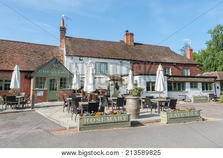 EVERSLEY, UK - MAY 10: The Chequers is an old traditional English pub dating back to the 17th century in the picturesque village of Eversley, UK on May 10, 2017