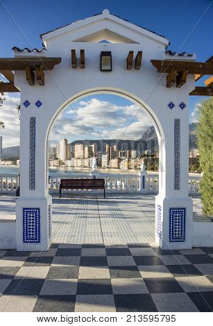 View of the coastline of Benidorm through an arch on the Plaza Old Town Benidorm Alicante Spain