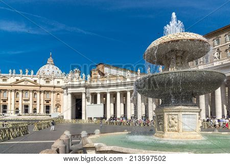 ROME, ITALY - JUNE 23, 2017: Tourists visit Saint Peter's Square and St. Peter's Basilica in Rome, Vatican, Italy