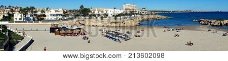 Orihuela Spain - November 5 2017: Panorama of Cala Capitan beach in the Cabo Roig popular place for holidaymakers. Province of Alicante. Costa Blanca. Spain