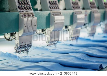 Industrial Embroidery Machine.Textile industry concpet via technology