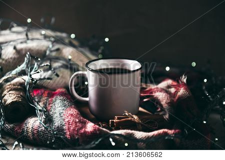 cup with herlands, Christmas and New Year, Cozy still life details in the living room. composition with Cup a