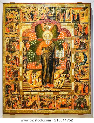 Veliky Novgorod Russia - August 17 2017: Antique Russian orthodox icon. St. John the Theologian with Scenes from his Life painted on old wooden board 17-th century