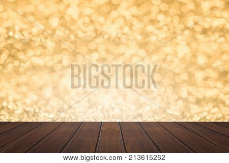 old brown and vintage top wooden shelf floor texture background can be used display product in Christmas day on gray and gold bokeh background.