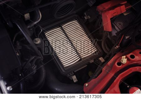 Air filter change maintenance Dirty air filter makes the air flowing through the intake manifold in the engine car less. Automotive parts concept.