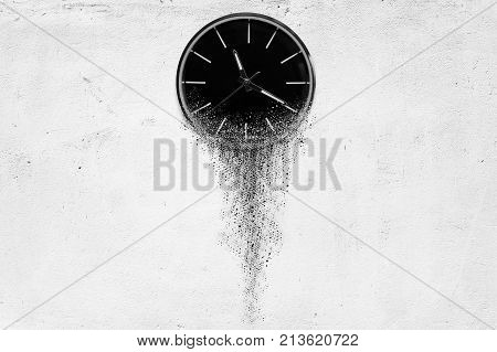 3d illustration of Classic clock on white concrete background disintegrates in a small parts and flowing away. Time flying concept