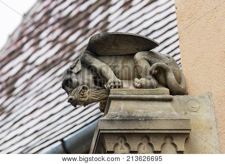 Sibiu Romania October 07 2017 : The top of the pillar is decorated with a gargoyle in Sibiu city in Romania