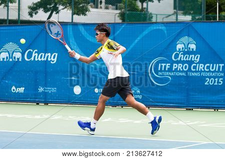 BANGKOK June 24 : Kittiphong Wachiramanowong of Thailand action in Chang ITF Pro Circuit International Tennis Federation 2015 at Rama Gardens Hotel on June 24 2015 in Bangkok Thailand.