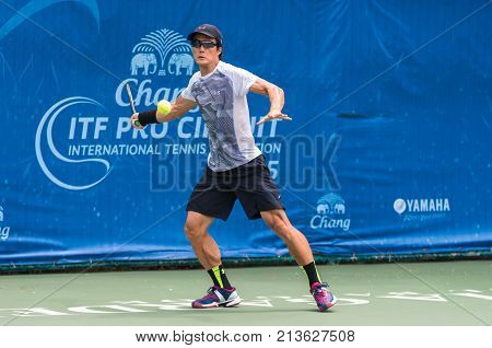 BANGKOK June 24 : Toshihide Matsui of Japan action in Chang ITF Pro Circuit International Tennis Federation 2015 at Rama Gardens Hotel on June 24 2015 in Bangkok Thailand.