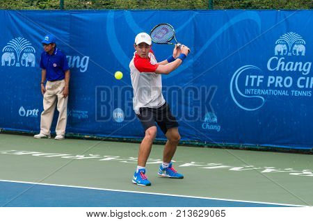 BANGKOK June 24 : Puriwat Chatpatcharoen of Thailand action in Chang ITF Pro Circuit International Tennis Federation 2015 at Rama Gardens Hotel on June 24 2015 in Bangkok Thailand.