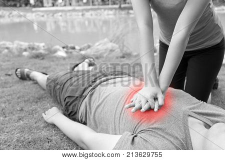 Woman giving cardiopulmonary resuscitation (CPR) to a man